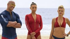 Dwayne Johnson as Mitch Buchannon, from left, Ilfenesh Hadera as Stephanie Holden and Kelly Rohrbach as CJ Parker in Baywatch.