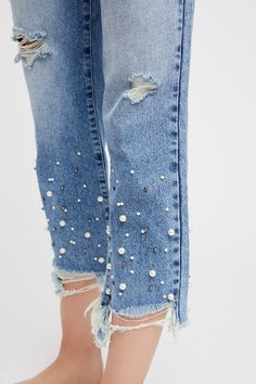 Pearl Crop Straight Leg Jeans | Embellished with pearl accents along the hem, these high-rise jeans are featured in a straight leg silhouette with distressed detailing.   * Rigid denim * Raw hem * Five-pocket style * Button closure and zip fly