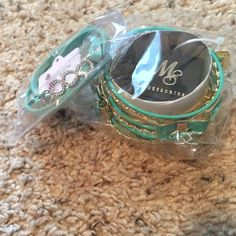 Brand new set of fashion bracelets Gold and turquoise bangles. Stackable. Other one is adjustable with rhinestone infinity symbols. Brand new, NO TRADES. Jewelry