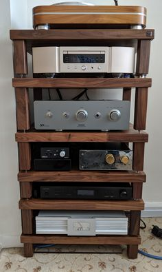 Another fantastic customer submission - a stunning solid walnut Podium Reference rack with @marantz, @sugdenaudio and @trigonaudio components. Renowned within the industry for its acoustic capabilities, the Podium Reference is a modular rack that can be customised to your choice of width, depth or height, just like this customer has tailored each tier to perfectly fit his components. Audiophile Music, Record Player Stand, Vinyl Storage, Modular Design, Media Center, Dining Room Furniture, Wood Colors, Solid Oak, Vinyl Records
