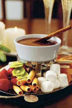 Chocolate Fondue - Wickedly Delicious Chocolate Desserts - Southernliving. Recipe: Chocolate Fondue Stir in additional heated whipping cream, 1 tablespoon at a time, if you want a thinner fondue. A fondue pot for chocolate is heated by a tea light or votive candle.