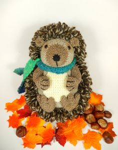 Hedley the Hedgehog Crochet Pattern Available in English or French* Hedley is much softer and cuddlier than you might expect a Hedgehog to be. He really doesnt like being cold so when hes not curled up and hibernating in a cozy little ball he always wears his favorite woolly scarf to keep him warm on his long rambling walks through the hedgerows.  Includes detailed instructions and clear photographs to help you create this soft and huggable character. When using light worsted weight (DK/...