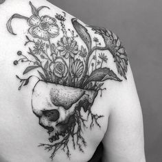 Skull flowers tattoo                                                                                                                                                     More