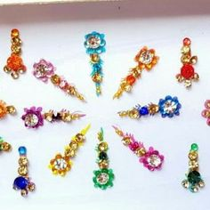 Colorful long crystal bindi available at Bindigalaxy Drawing Heads, Head Crown, Bindi, Crowns, Beaded Bracelets, Colorful, Drop Earrings, Trending Outfits, Crystals