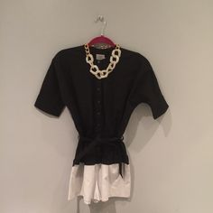 """Urban Outfitters ~Alice & UO~ Shorts Romper S/P Urban Outfitters ~Alice & UO~ Shorts Romper S/P. Black & White. Belted. Button-Front. Elastic at waist. Short Sleeve. Machine Wash. NWT  ❌ NO SWAPS/TRADES ✅ BUNDLES - Please message if interested ✅ PRICES ARE NEGOTIABLE  APPROX MEASUREMENTS : Bust: 34"""" Waist: 26""""/27"""" Hips: 36""""/37"""" Urban Outfitters Shorts"""