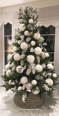 100 White Christmas Decor Ideas Which are Effortlessly Elegant & Luxurious - Hike n Dip - - Here are best White Christmas Decor ideas. From White Christmas Tree decor to Table top trees to Alternative trees to Christmas home decor in White & Silver. Elegant Christmas Trees, Decoration Christmas, Christmas Tree Design, Christmas Tree Themes, Noel Christmas, Rustic Christmas, Christmas Wreaths, Christmas Tree Ideas, Christmas Tree With White Decorations