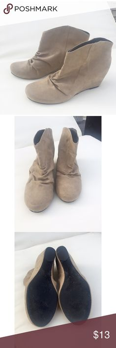 Express suede tan colored booties Express tan colored booties. Suede material , ruched in front . Small heel. Gently worn , in 4th picture on back of shoe some discoloration . Size 10. Express Shoes Ankle Boots & Booties