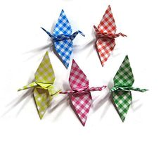 <3 <3 <3 Origami Cranes in bright primary colors  <3 <3 <3 These checker pattern birds are sure to brighten your party! And check them out....! NO FOLDING CREASE ON THE WINGS!