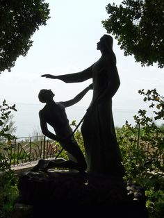 "Sea of Galilee - Statue of Jesus asking Peter ""Do you love me? Feed my sheep."""