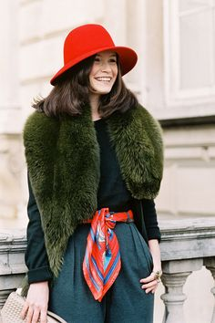 Fur stole + cute hat and the kind of smile that lights up a room
