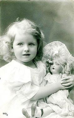 a little girl with her doll