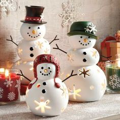 #PartyLite snow family! Hand-painted porcelain trio each hold a tealight candle. Sold as a set or separately.