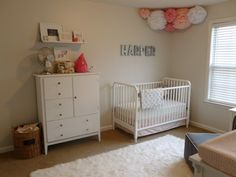 pink peach girls nursery.. tissue paper flowers yes
