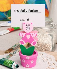 Pink Teddy Bear/Flower Pot Place Card/Photo Holder - When you choose this darling favor for your little girl's big day, you can transform the room into a garden of love and smiles. http://www.favorfavorbaby.com/p-6133.htm