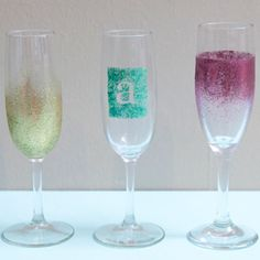 I propose a toast to these Champagne Shimmer Toasting Glasses! DIY #wedding favors and party crafts like these embellished champagne glasses make wonderful DIY wedding gifts and homemade hostess gifts for classy parties.