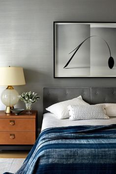 If you're ready to experiment with this neutral shade in your own abode, click through 34 of our favorite gray bedrooms for inspiration. #graybedroom #grayroomideas #grayinteriordesign #graymasterbedroom