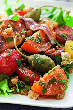 This simple salad, topped with crunchy garlicky breadcrumbs, is the perfect vehicle to showcase a unique, colorful mix of tomatoes--any size, shape or color will be delicious. While sherry vinegar adds a special touch, red-wine vinegar works too. #salads #saladrecipes #healthysalads #saladideas #healthyrecipes