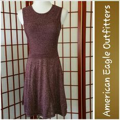 Super Cute Dress! Super cute dress from AEO.  Burgundy.  Thin sweater like.  Sz Sm.  Measurements lying flat armpit to armpit 14in, waist 12in, length 32in.  Excellent condition.  No rips, stains, or tears.  From smoke free home. American Eagle Outfitters Dresses