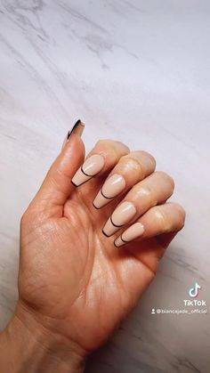 Step by step video of a fun trending #manicure to get on long nails. Use an opaque muted pink tone for the base and black for the outline. #nailsideas #nails #manicureideas #nailart #nailsdesign #nailsvideos