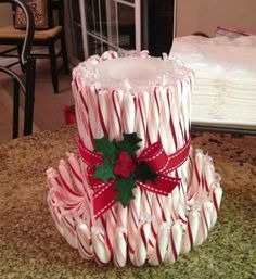 easy candy cane candle, take a candle and wrap any of your favorite candy cane flavors around it. and your done beautiful centerpiece - Candy cane party decor ideas - Candy Canes - Christmas Candy Cane Crafts Homemade Christmas, Diy Christmas Gifts, Simple Christmas, Christmas Projects, Christmas Wrapping, Christmas Time, Christmas Ideas, Nordic Christmas, Modern Christmas