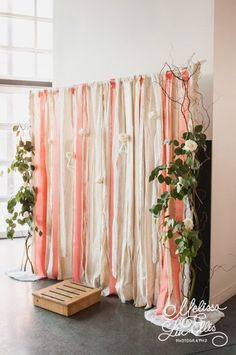Pick an assortment of ribbons that complement the color scheme of your party decor and tie them to the top rail of the backdrop stand. Frame with some flowers and you're good to go!