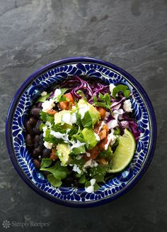 Try whipping up this #Burrito Bowl with black beans, rice, avocados, salsa, red cabbage, and lime. #recipe