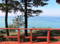 Red House - Sleeps 10. Unique setting features both woods and Lake Michigan waterfront.