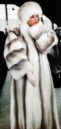 Long, full white and grey fur coat and hat