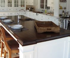 "2 1/4"" thick walnut premium wide plank island. American Brown #2 color with Marine Oil Finish and an ogee-F edge."
