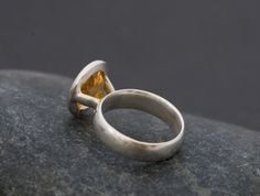 Lovely oval citrine ring.  Light orange citrine set in satin finished sterling silver. Citrine is 10mm x 12mm  This ring is made to order so please let me know your ring size when you place your order.  Your ring will come in a black gift box with a black bow.  FREE SHIPPING  To visit my shop, please go to https://www.etsy.com/shop/williamwhite  All jewellery is hand made by me in Cornwall, south-west England