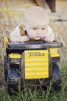 3 month old boy session.  Not that happy about being in dump truck