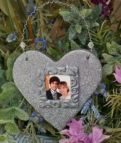 """Your photo is reproduced to fit the handcrafted frame.  Every Heart is sprinkled with """"angel dust"""" to make it twinkle,  This great Photo Memory Keepsake makes an excellent give for any special occasion. The backside can be backstamped with the name and date of your choice."""