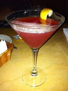 Ritz Martini - Courvoisier, Champagne, Cointreau, and Pomegranate Juice