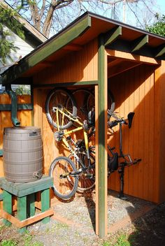 The west end is a shelter for our bikes. It's open on two sides for easy access. The roof catches quite a bit of rain so we added a gutter on the low side and channeled the water into a rain barrel.