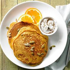 We're firm believers that pumpkin belongs in all three meals of the day, so we've added the signature fall flavor to fluffy homemade pancakes.