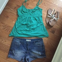 Super cute tank Vneck top with adjustable straps and back tie. Top only can be sold with shorts and sandals for additional bundle costs Tops Tank Tops