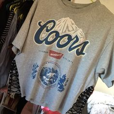 LF vintage lace up tee This is a vintage Coors light t-shirt that has two slits on the bottom and is laced up. It's super cute and an alternative to the traditional lace up tees. This is handmade with love  LF Tops Tees - Short Sleeve