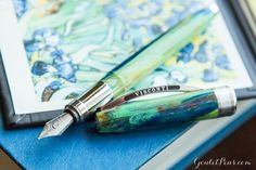 Made from natural resin uniquely mixed to represent palettes of oil paint, this Visconti Van Gogh series is inspired by the artist's color and technique. Each pen represents a specific Van Gogh painting. The pen utilizes Visconti's eighteen-faceted design, with the many edges enhancing its vivid colors. This Irises fountain pen features a steel nib in medium. A converter is included, and it also accepts standard international short cartridges. It comes packaged in a unique gift box th...