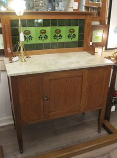 Oak washstand with unusual original mounded tiles
