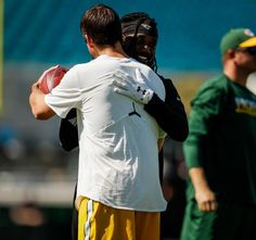 9/11/2016 Former Packer Davon House and Aaron Rodgers share a hug.