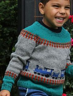 Free Knitting Pattern for Train Sweater - Child's long-sleeved pullover with train and tracks motifs. Sizes 2 yrs/92 cl (4 yrs /104 cl) 6 yrs /116 cl (8 yrs /128 cl) 10 yrs /140 cl. Futfut designed by Karen S. Lauger for Filcolana. Available in English, Danish, and German