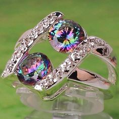 '7, 8, 9 - Stunning Rainbow & White Topaz Ring' is going up for auction at  7am Thu, Aug 23 with a starting bid of $6.