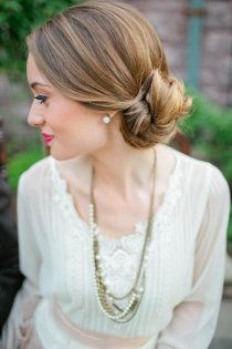 pretty side-swept hair! I know you said you were thinking about that. This style would look great with a birdcage veil too