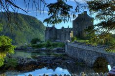 raindropsonroses-65:  Eilean Donan Castle A summer's evening by Ian Horne.