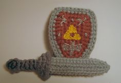 Links Sword and Shield Pattern - this is miniature, I'm bummed. Wanted a big one. I tried to make the pattern larger but it did not work out.