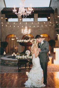 Wedding chandeliers as elegant lighting. Captured By: Lauren Scotti Photography http://www.weddingchicks.com/2014/06/06/shabby-chic-plaza-wedding/
