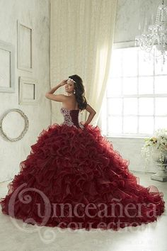 A full, ruffle organza skirt with small AB rhinestones sparsely decorating some of the wire-edge ruffles and a sweetheart bodice lavished in chunky beadwork. A perfect beginning to any Quinceanera. Do