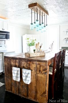 I LOVE this farmhouse kitchen island and the matching mason jar light