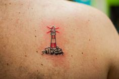 Lighthouse Tattoo by Wes Hawkins of New Age Tattoo of Marquette MI done during our UPAWS fundraiser to raise money for the local no kill animal shelter. To see more of his work follow the studio on instagram at @ newagetattoo