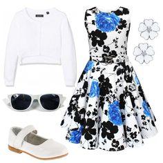Il vestitino a fantasia floreale con gonna a ruota è abbinato al cardigan bianco per un look anni '50. Ai piedi le ballerine con cinturino. Per finire, occhiali da sole e orecchini a forma di fiore.